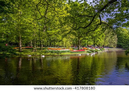Beautiful lake with green trees, Keukenhof Park, Lisse in Holland.