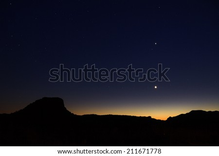 Beautiful landscape after sunset with the moon, Jupiter and Venus, seen from Isalo, Madagascar - stock photo