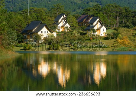 Beautiful landscape at Dalat village, group of villas reflect on lake, eco holiday resort among green pine forest, fresh air, pure environment, romantic scene for honeymoon at Da Lat, Vietnam