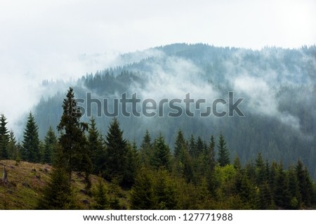 Beautiful landscape at the mountains with clouds - stock photo