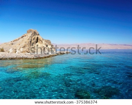 Beautiful landscape blue sunny tropical sea nature background near holiday luxury  island resort with atoll coral reef and ancient church - stock photo