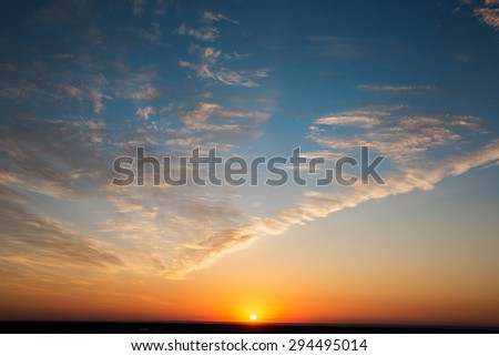Beautiful landscape dawn sky with reflection in the clouds with sunlight - stock photo