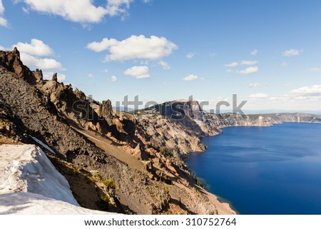 Beautiful landscape in Crater Lake with a deep blue color in the lake and a sloping crater - stock photo