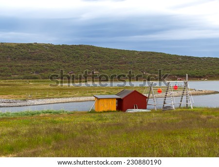 beautiful landscape in Norway - lonely fishers' house on cloudy day - stock photo