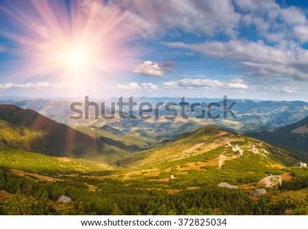 Beautiful landscape in the mountains at sunshine.View from the top of  peak. - stock photo