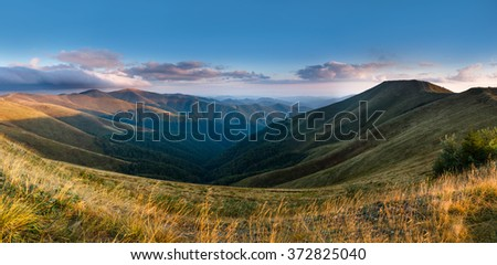 Beautiful landscape in the mountains. View from the top of  peak. - stock photo