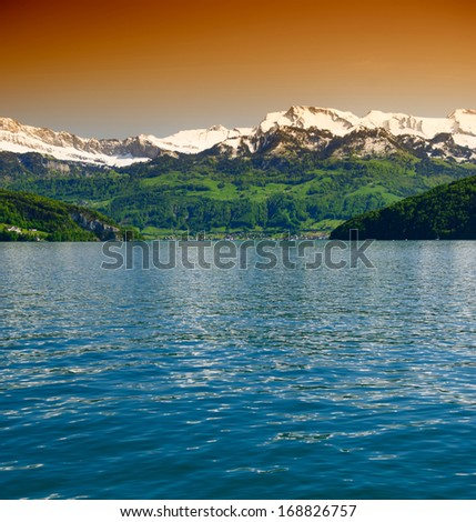 beautiful landscape lake and mountains with snowy peaks Switzerland