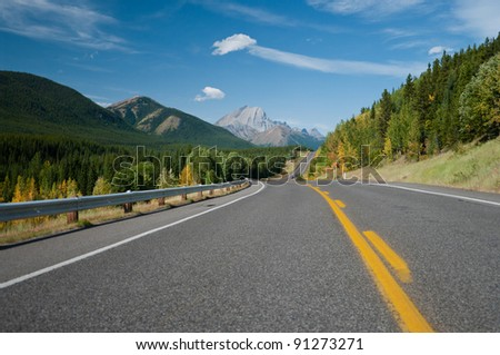 Beautiful landscape of a road through Rocky Mountains - stock photo
