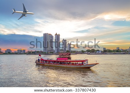 Beautiful landscape of airplane flying over business city , river ferry boat at sunset.