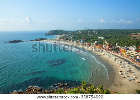 Beautiful landscape of beach and clear turquoise sea. Thiruvananthapuram, India