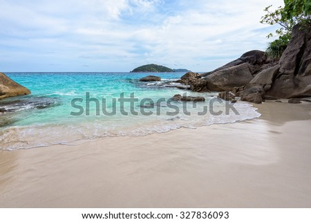 Beautiful landscape of blue sea sand and white waves on small beach near the rocks during summer at Koh Miang island in Mu Ko Similan National Park, Phang Nga province, Thailand