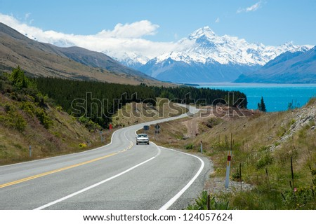 Beautiful landscape of car, road, lake and snow mountain in South Island, New Zealand - stock photo
