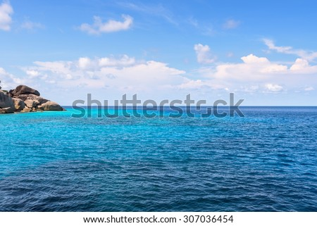 Beautiful landscape of clear sky over small island and blue sea middle Andaman Ocean in summer at Mu Koh Similan National Park, Phang Nga Province, Thailand