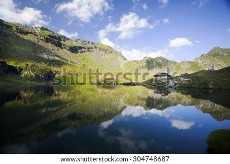 Beautiful landscape of glacier lake and high mountains reflecting in water