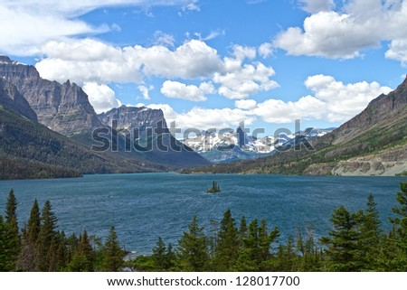 Beautiful landscape of mountains and St. Mary Lake in Glacier National Park, Montana - stock photo