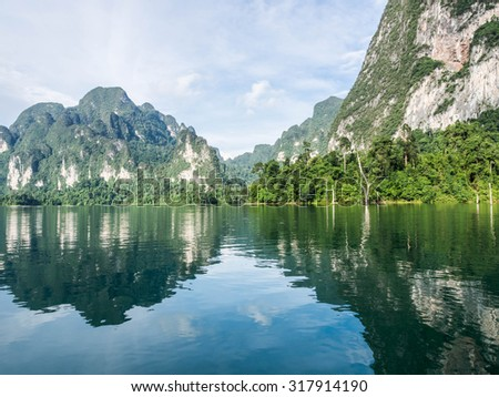 beautiful landscape of mountains, cloud and water of the dam at Khao Sok national park, Suratthani province in Thailand