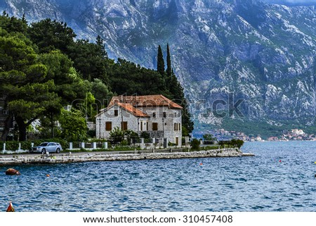 Beautiful landscape of Perast - historic town on the shore of the Boka Kotor bay (Boka Kotorska), Montenegro, Europe. Kotor Bay is a UNESCO World Heritage Site. - stock photo