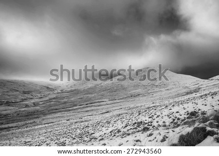 Beautiful landscape of snow covered mountain in Winter in black and white - stock photo