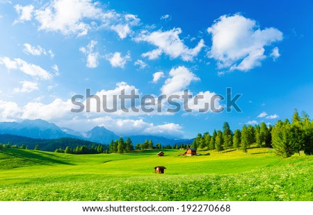 Beautiful landscape of valley in Alpine mountains, small houses in Seefeld, rural scene, majestic picturesque view in sunny day - stock photo