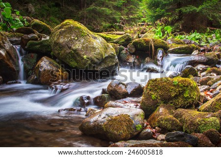 Beautiful landscape rapids on a mountains river and small waterfall. Filtered image: colorful effect.  - stock photo