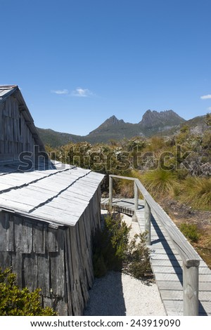 Beautiful landscape scenery of Cradle Mountain National Park in Tasmania, Australia, with historic shed, blue sky as copy space. - stock photo