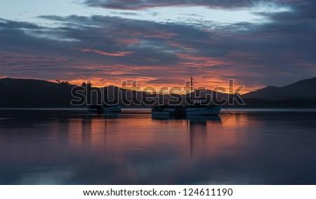 Beautiful landscape sunrise at sea from west coast, Waikawa Harbour, South island New Zealand - stock photo