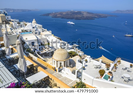 Beautiful landscape view to the sea and Volcano from Fira without people or tourists early in the morning. Santorini island in Cyclades, Greece