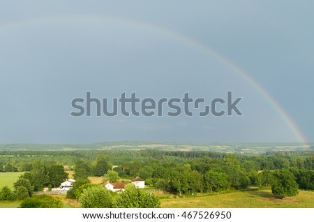 Beautiful landscape with a rainbow in Burgundy, France .