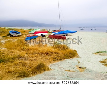 Beautiful landscape with colorful fishing boats in Galicia, Spain