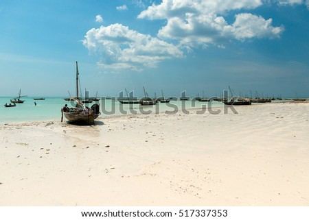 beautiful landscape with fishing boats on the shore, Zanzibar, Africa