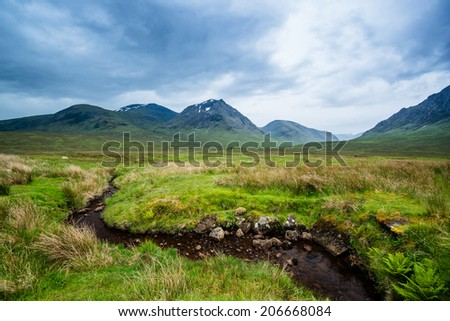 Beautiful landscape with Glencoe or Glen Coe mountains and pass with panoramic view over beautiful landscape in the Scottish Higlands, Scotland. UK. - stock photo