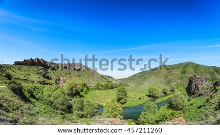 Beautiful landscape with green hills and magnificent blue sky. Exploring Armenia - stock photo