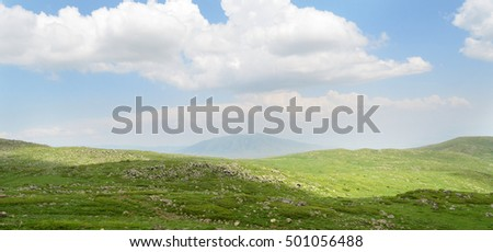 Beautiful landscape with green mountains and magnificent cloudy sky in Armenia