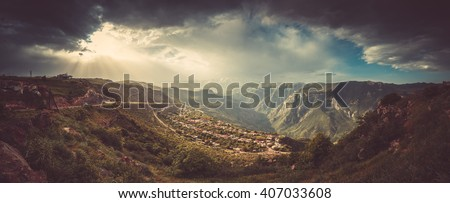 Beautiful landscape with green mountains and magnificent cloudy sky in sunset. Exploring Armenia - stock photo