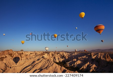 beautiful landscape with hot air balloons and mountains in Cappadocia, Turkey - stock photo