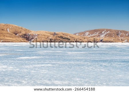 Beautiful landscape with ice and snow on the lake. Small depth of field.  - stock photo