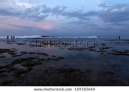 Beautiful landscape with low water in twilight on Balangan beach - stock photo