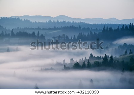 beautiful landscape with mountain view and morning fog on sunrise.  amazing natural background