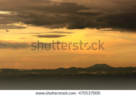 Beautiful landscape with mountains and magnificent cloudy sky in sunset