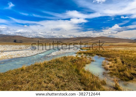 Beautiful landscape with mountains, river and blue sky. Plateau Ukok, Altai - stock photo