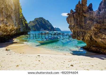 Beautiful landscape with palms, beach and sea El-nido, Palawan, Philippines