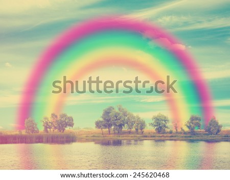 beautiful landscape with rainbow, retro film filtered, instagram style  - stock photo