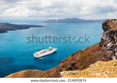 Beautiful landscape with sea view. Cruise liner at the sea near the islands. Santorini island, Greece. - stock photo