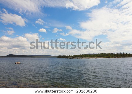Beautiful landscape with silent lake and forest
