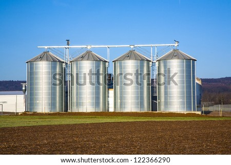 beautiful landscape with silo and  blue sky - stock photo