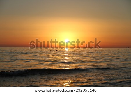 Beautiful landscape with sunset and sea - stock photo
