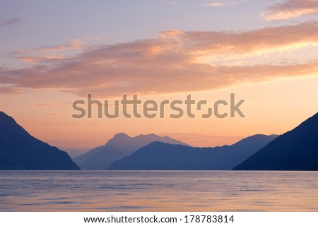 Beautiful landscape with sunset at the fjord with clouds, Norway - stock photo