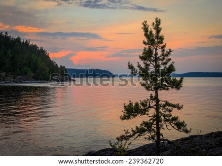 beautiful landscape with sunset over the lake - stock photo