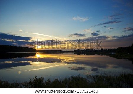 Beautiful landscape with sunset over the river - stock photo