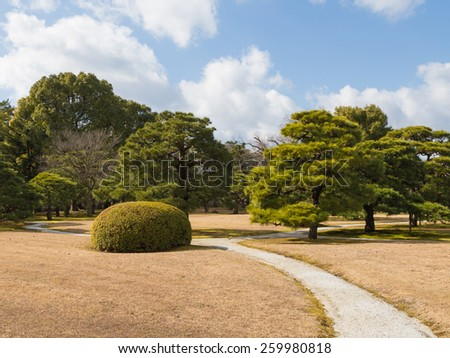 beautiful landscaped park with paths in the early spring - stock photo